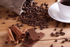 Coffee with shekoladom. Natural coffee with chocolate on a wooden table Royalty Free Stock Photo