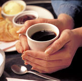 Coffee shop. Female hands holding cup of Coffee in Coffee shop Stock Photography
