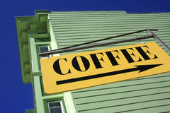 Coffee shop. Yellow sign pointing towards Coffee Royalty Free Stock Photos