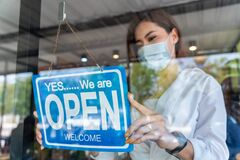 Free Coffee Shop Asian Woman Owner With Face Mask, Open After Lockdown Quarantine In Cafe Covid-19 Preventing Royalty Free Stock Photo - 213436305