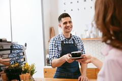 Coffee Shop. Barista Giving Cup Of Coffee To Customer Stock Photography