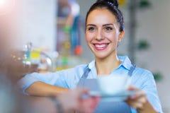 Coffee shop barista serving coffee Stock Image