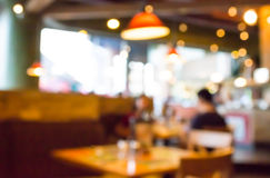 Coffee shop blur background with bokeh image. Coffee shop blur background with bokeh image Royalty Free Stock Photography