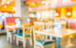 Coffee shop blur background with bokeh image. Royalty Free Stock Photo