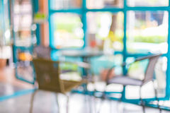 Coffee shop blur background with bokeh image . Royalty Free Stock Photo