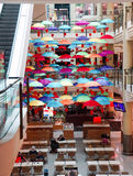 Coffee shop with bright colourful umbrellas. Glorious colourful umbrellas decorating a coffee shop in the mall Royalty Free Stock Images