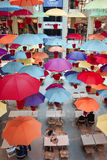 Bright colourful umbrellas. Glorious colourful umbrellas decorating a coffee shop in the mall Royalty Free Stock Photos