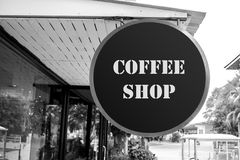 Coffee shop sign board. Coffee shop, coffee cafe sign board in front of the shop. Black and white filter Royalty Free Stock Images
