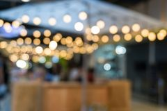 Coffee shop in department store blur background with bokeh royalty free stock image