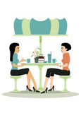 Coffee shop. Female friends are talking at a table in a coffee shop Stock Photo
