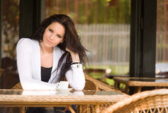 Coffee shop girl. Gorgeous young brunette hanging out at the coffee shop Stock Photo