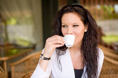 Coffee shop girl. Gorgeous young brunette hanging out at the coffee shop Royalty Free Stock Photos