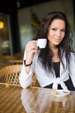 Coffee shop girl. Gorgeous young brunette hanging out at the coffee shop Royalty Free Stock Photography