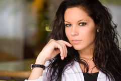 Coffee shop girl. Gorgeous young brunette hanging out at the coffee shop Royalty Free Stock Images