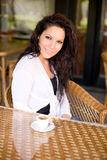 Coffee shop girl. Gorgeous young brunette hanging out at the coffee shop Stock Photos