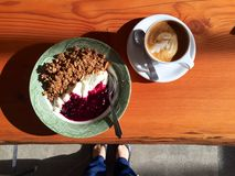 Coffee shop: latte and granola with yogurt and fruit compote Stock Image