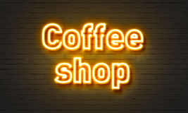 Coffee shop neon sign on brick wall background. royalty free stock photo