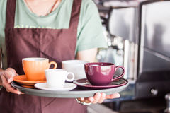 Coffee shop owner serving set of freshly brewed coffee Stock Photo