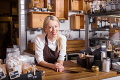 Coffee shop owner standing behind the counter Royalty Free Stock Photo