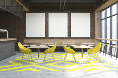 Coffee shop with posters, yellow Stock Photo