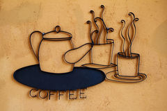 Coffee shop sign. On the dark yellow plastered wall Royalty Free Stock Photos
