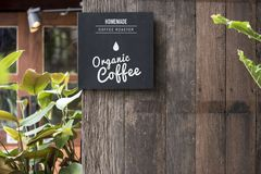 A coffee shop sign hanged outside Stock Photo