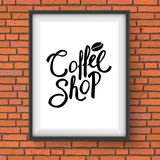 Coffee Shop Sign Hanging on Red Brick Wall Royalty Free Stock Photos