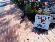 Coffee shop sign on sidewalk Royalty Free Stock Photography
