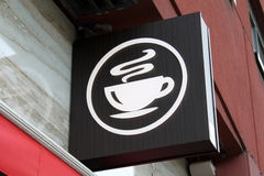 Coffee shop sign. Sign of steaming cup of hot coffee outside of a coffee shop Royalty Free Stock Images