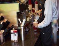 Coffee shop staff making coffee. Closeup of a coffee shop waiter making coffee Stock Photo