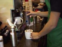 Coffee shop staff making coffee Stock Photos