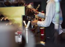 Coffee shop staff steaming milk Royalty Free Stock Photos