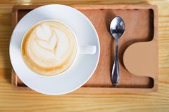 Coffee house counter background with coffe cup, top view Stock Images