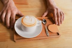 Coffee house counter background with coffe cup, top view Stock Image