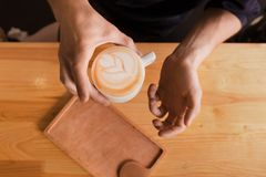 Coffee house counter background with coffe cup, top view Royalty Free Stock Photos