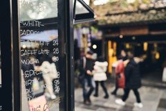 Coffee shops and streets. 。The price on the window and the mall stock photos