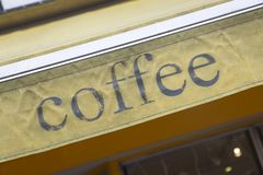 Coffee Sign on Building Facade Royalty Free Stock Photo