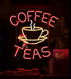 Coffee Sign. A red and yellow neon sign reading Coffee Teas Royalty Free Stock Images