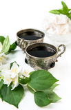 Coffee in silver vintage cups and arabic sweets. Coffee in silver vintage cups, jasmine, Arabic style, close-up, selective focus Royalty Free Stock Photo