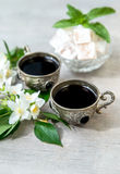 Coffee in silver vintage cups and arabic sweets Royalty Free Stock Photos