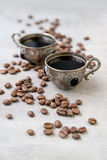 Coffee in silver vintage cups on wooden background. Close-up of coffee in silver vintage cups on wooden background, Arabic style, selective focus Royalty Free Stock Photos