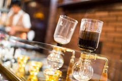 Coffee siphon in use Royalty Free Stock Photo