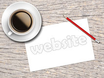 Coffee and sketch paper written website on the wooden table Stock Images