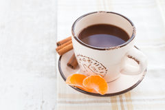 Coffee with slices of mandarin. And cinnamon Stock Images