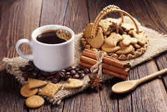 Coffee and small decorative cookies Stock Images