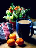 Coffee and small oranges on a wooden table Royalty Free Stock Photo