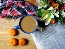 Coffee and small oranges on a wooden table Royalty Free Stock Photos