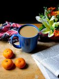 Coffee and small oranges on a wooden table Stock Photo