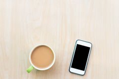 Coffee and smart phone. Breakfast in the morning. On an copy space and using smart phone. The Creative modern Business top view Royalty Free Stock Images