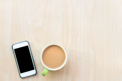 Coffee and smart phone. Breakfast in the morning. On an copy space and using smart phone. The Creative modern Business top view Stock Photos